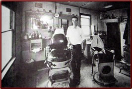 LaGrange Wyoming history - Cletis Arnold in his barber shop early 1930s