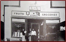 Wyoming State History - Lloyd & Lila Craton in front of their grocery store, 1930s